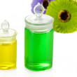Stock Photo: Bottles with colored liquids isolated on white