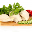 Boiled chicken breast on wooden cutting board with vegetables isolated on white — Stock Photo #29252985