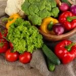 Fresh vegetables on burlap background — Stock Photo #29253225