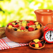 Stock Photo: Oatmeal with fruits on table on bright background