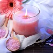 Beautiful pink candle with flower on bamboo mat — Stock Photo #29253595