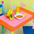 tasty baby fruit puree and baby bottle on table in room — Stock Photo #29253809