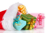 Beautiful Christmas hat and gifts isolated on white — 图库照片