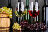 Assortment of wine in glasses and bottles on grey background — Stock Photo