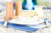 Tasty dumplings on white plate, on bright background — Stock Photo