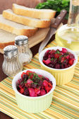 Beet salad in bowls on table close-up — Stock Photo