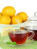 Cup of tea with lemon on table on white background — Stock Photo