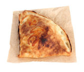 Pizza calzone on tracing paper isolated on white — Stock Photo