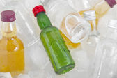 Minibar bottles with ice cubes, close-up — Stock Photo