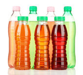 Bottles with tasty drinks, isolated on white — Stock Photo