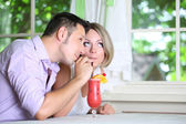 Beautiful couple drinking together cocktail at restaurant — Stock Photo