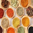 Assortment of spices in wooden spoons — Stock Photo #29288815