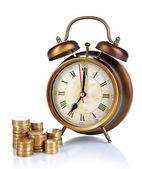 Antique clock and coins isolated on white — Stock Photo