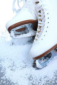 Figure skates in snow close-up — Stock Photo