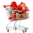 Beautiful golden gifts with red ribbon and Christmas balls in shopping cart isolated on white — Stock Photo #29302071