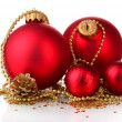 Beautiful red Christmas balls and cones isolated on white — Stock Photo