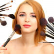 Portrait of beautiful woman   with make-up brushes — Photo