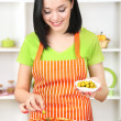 Girl housewife with delicious pizza on kitchen background — Stock Photo
