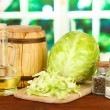 Green cabbage, oil, spices on cutting board, on bright background — Foto Stock #29302803