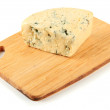Stock Photo: Tasty blue cheese on cutting board, isolated on white
