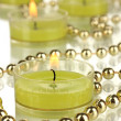 Lighted candles with beads close up — Foto de Stock