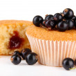 Tasty muffins with berries isolated on white — Stock Photo