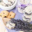 Still life with jar of lavender sugar, mortar and fresh lavender flowers on wooden background — Stock Photo