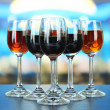 Stock Photo: Glasses of liquors, on bright background