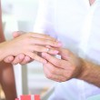 A man proposing and holding up an engagement ring — Stock Photo