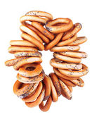 Tasty bagels on rope, isolated on white — Stock Photo