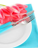Festive dining table setting with tulips isolated on white — Stock Photo