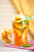 Iced tea with lemon and mint on wooden table — ストック写真