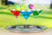 Different cocktails on bright background — Stock Photo