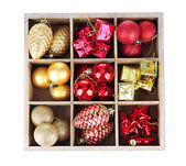 Wooden box filled with christmas decorations, isolated on white — ストック写真