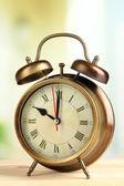 Old alarm clock on bright background — Stock Photo
