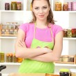 Young woman cooking in kitchen — Stock Photo #29311775