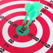 Stock Photo: Target with darts close-up