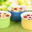 Delicious yogurt with fruit on table on bright background — ストック写真