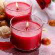 Beautiful red candles with flower petals in water — Stock Photo #29313217