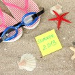 Composition with flip flops, goggles on sand background — Stock fotografie