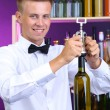 Bartender opens bottle of wine — Stock Photo #29314931
