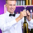 Bartender opens bottle of wine — Stock Photo #29314965