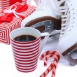 Figure skates with cup of coffee isolated on white — Stock fotografie