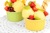 Delicious ice cream with fruits and berries in bowl close up — Stock Photo