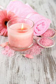 Beautiful spa setting with pink candle and flower on wooden background — Stock Photo