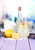 Lavender lemonade, on violet wooden table, on bright background — Stock Photo