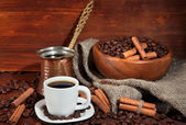 Coffee cup and metal turk on wooden background — Stock Photo