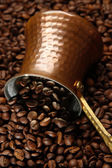 Metal turk on coffee beans background — Stock Photo