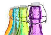 Kolorowe butelki na białym tle — Zdjęcie stockowe
