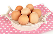Eggs in plate for eggs isolated on white — Stock Photo